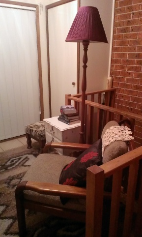 A similar photo to the 'before' shot, but showing a footstool, and a dresser to hold the books