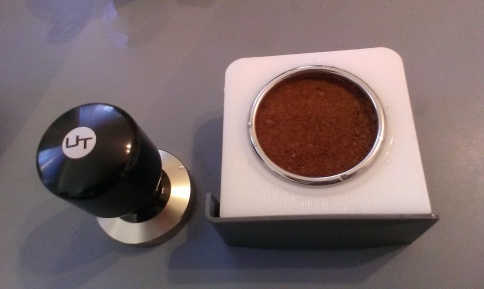 The grinds draw (with my tasty coffee) and coffee press, which is lovely and weighty.